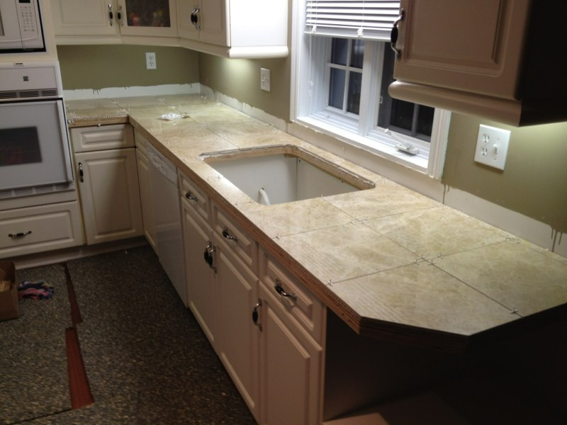 ... Installing New Cabinets Under The Island, Installing A Decorative Post  Under The Island To Support The Weight Of The New Tile And Tiling The  Countertop ...